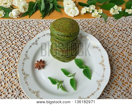 Nettles green pancakes with rose petals cooking organic food with weed