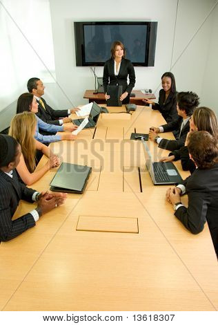 businesspeople in a business meeting in an office smiling