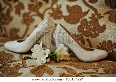 Wedding Shoes With Buttonhole On Texture Background