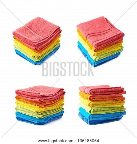 Pile of multiple rainbow colored towels isolated over the white background, set collection of four different foreshortenings