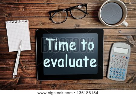 The words Time to evaluate on tablet pc