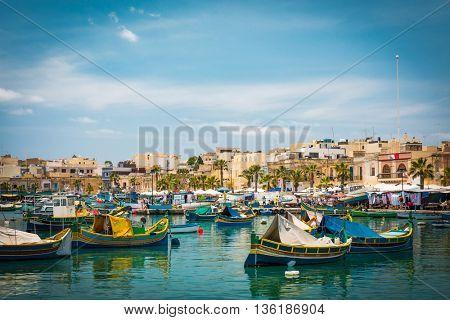 Marsaxlokk, Malta - 24 May 2015: fishing boats near fishing village of Marsaxlokk (Marsascala) in Malta