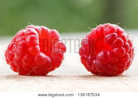 Lots of raspberry and blackberry on background.