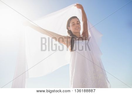 Happy woman standing on the beach