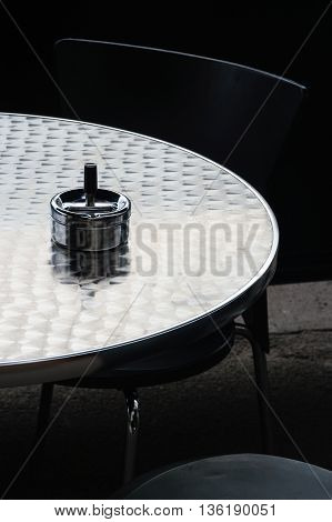 table in a restaurant with an ash trash