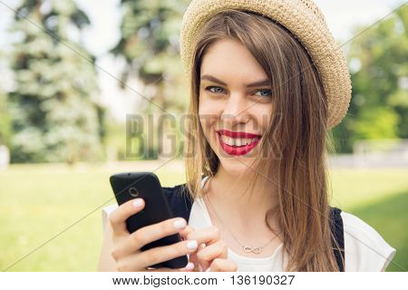 Young Hipster Girl With Trendy Look Chatting On Smart Phone