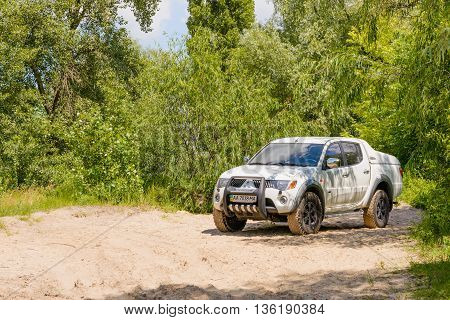 Kiev/Ukraine - June 16 2016 - White Mitsubishi Pickup in the sand