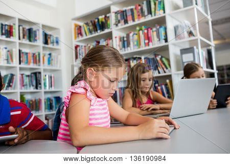 children using technology in library
