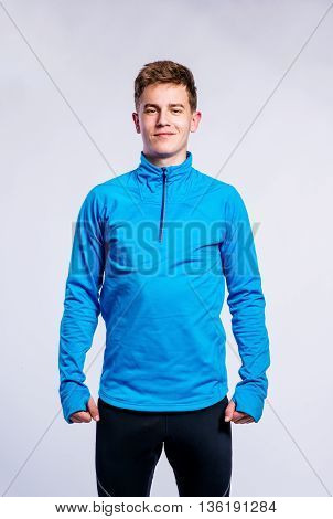 Boy In Blue Sports Sweatshirt, Young Man, Studio Shot
