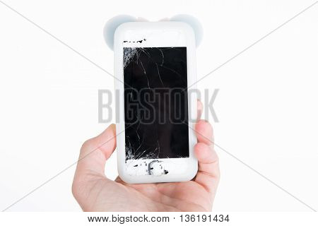 Hand holding out her broken touch screen mobile phone