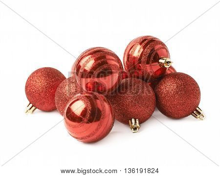 Pile of decorational red Christmas tree balls isolated over the white background