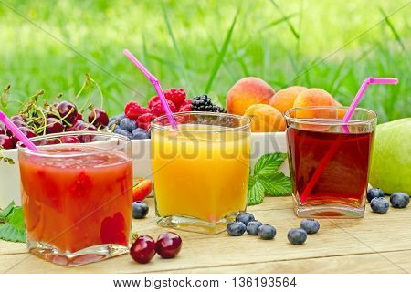 Fresh fruit drinks made with organic fruit - healthy refreshing beverage
