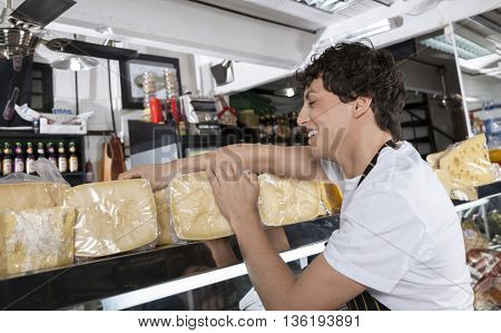 Salesman Working In Cheese Shop