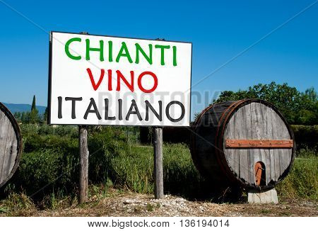 Traditional wooden barrel with a billboard that advertises the sale of wine in the Tuscan countryside