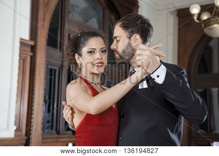 Argentine Tango Dancer Performing Gentle Embrace Step With Partn
