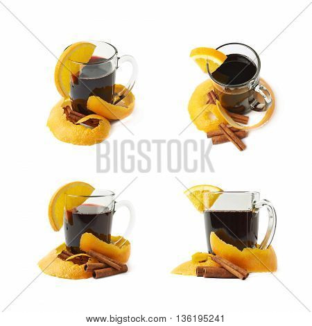 Glass of mulled wine decorated with the cinnamon sticks, peels and slice of orange, composition isolated over the white background, set of four different foreshortenings