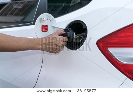 Hand opening the oil filler cap. pump, diesel