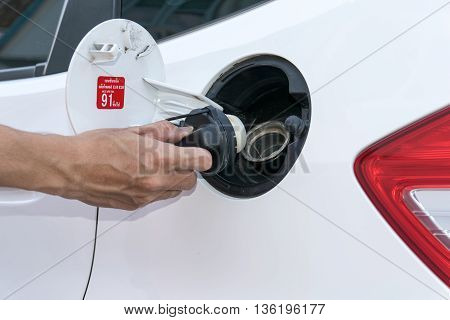 Hand opening the oil filler cap. cap, car, gas, service, hand