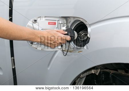 Hand opening the oil filler cap. cap, car, gas,