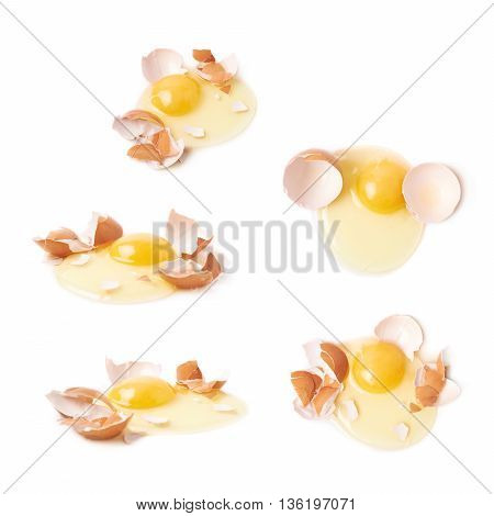 Cracked raw chicken egg and broken shell composition, isolated over the white background, set of five different foreshortenings