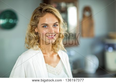 Portrait of beautiful young woman with blond hair smiling at home