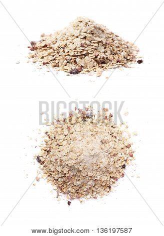 Pile of oatmeal groats porridge mixed with dried fruit pieces, composition isolated over the white background, set of two different foreshortenings