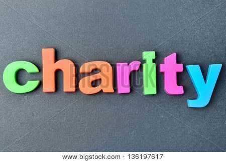 The colorful word Charity on gray background