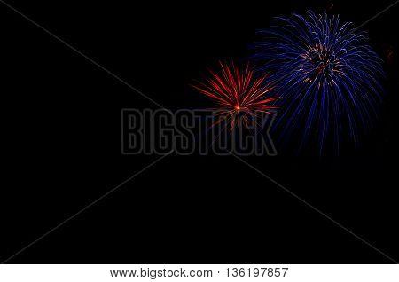 Firework Over Dark Sky In Summer Night
