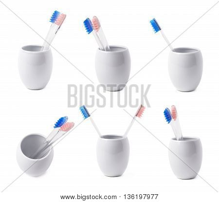 Composition of two toothbrushes with a blue and pink colored bristles in a white ceramic cup, isolated over the white background, set of six different foreshortenings