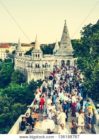 Budapest, Hungary - July 07, 2015: people on terrace and Mathias Church in Fishermen Bastion top view