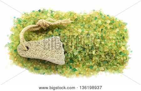 background of large salt crystals colorful yellow green bath with juniper spa pumice in the form of a foot with a rope