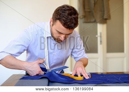Portrait of tailor working on a piece of fabric