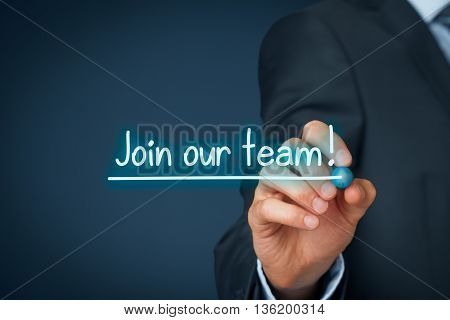 Businessman (recruiter or HR staffer) write and underline text join our team.