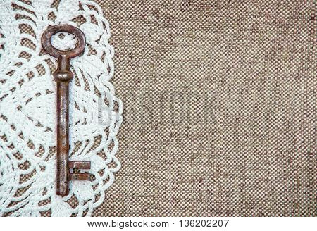 Vintage Background With Lacy And Old Key On Burlap Texture