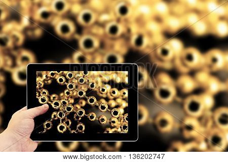 Tablet Photography Concept. Taking Pictures On A Tablet. Yellow Gold Pearl Necklace Macro Abstract B