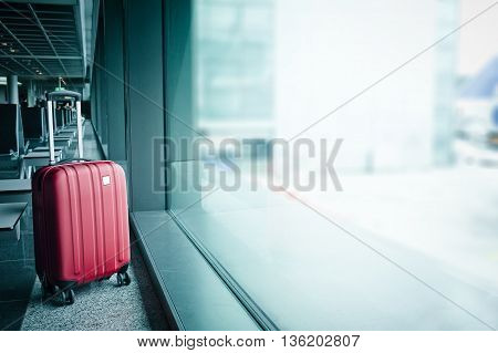 Suitcase in airport in the waiting hall