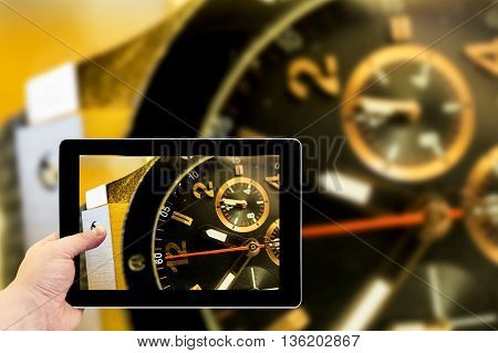 Tablet Photography Concept. Taking Pictures On A Tablet. Gold Watch Macro
