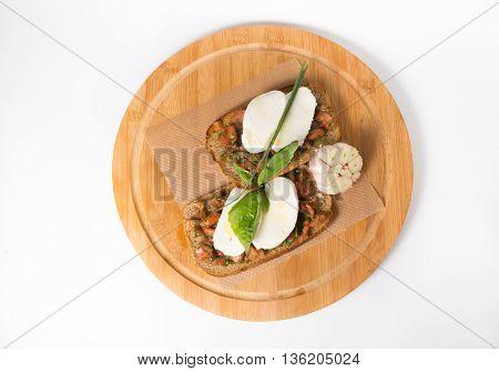 Italian bread with mozzarella cheeze on wooden board