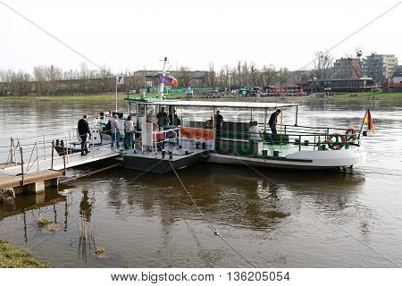 MAGDEBURG, GERMANY - April 3, 2016: Ferry on the river Elbe in Magdeburg. The ferry takes passengers from the city park on the other riverbank to district Buckau