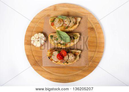 Italian sandwich. Bruschetta on a wooden board