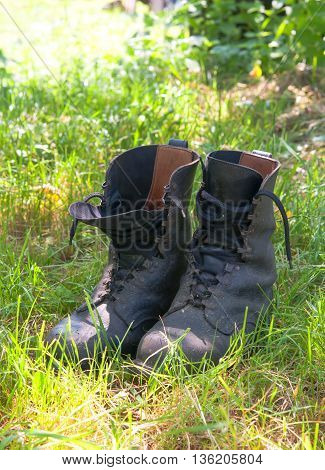 dirty hiking (military) boots in the photo