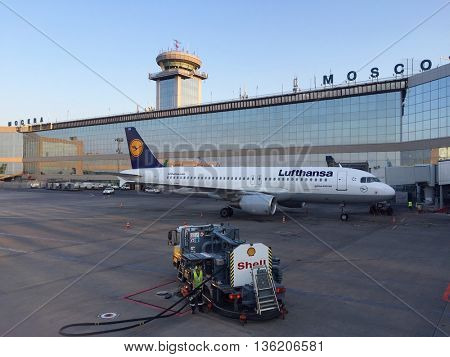 MOSCOW - JUNE 27: Aircraft and service vehicles parked airside at Moscow Domodedovo International Airport on the morning of June 27, 2016 in Moscow, Russia.