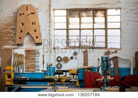 Tools and equipment used for carpentry in a dusty workshop