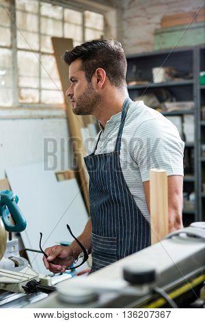Carpenter focusing on his workshop