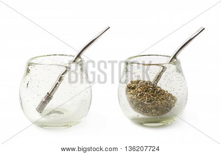 Glass mate calabash vessel with a dry mate tea leaves and bombilla drinking straw inside it, composition isolated over the white background, set of two different foreshortenings