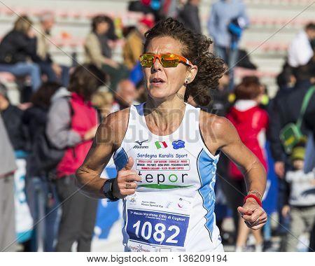 CAGLIARI, ITALY - December 7, 2014: 7 ^ Half Marathon - Memorial Delio Serra - portrait of a woman at the end of the race