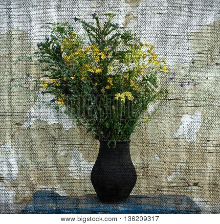 Wildflowers bouquet in a black clay pot on a background of a white shabby wall - Photo made with canvas texture effect