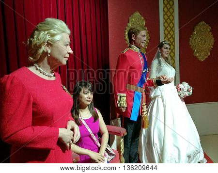 Da Nang, Vietnam - Jun 20, 2016: Queen Elizabeth and British Royal Family wax statue on display at Ba Na Hills mountain resort.