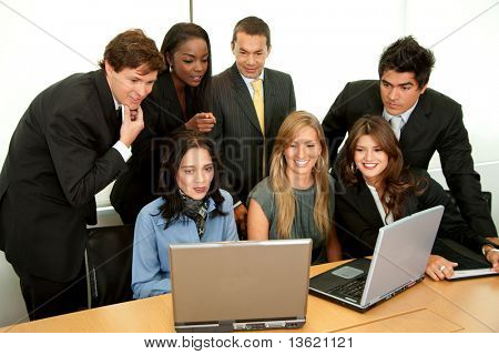 business people in a meeting with a laptop