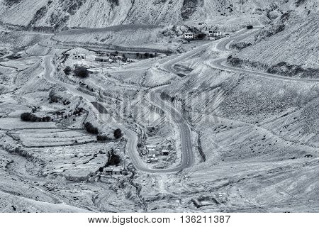 Aerial view of Zigzag road - famously known as jilabi road at old route of Leh Srinagar Highway Ladakh Jammu and Kashmir India. Beautiful black and white stock image.